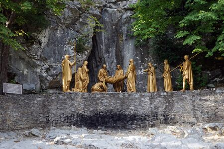 crist: LOURDES, FRANCE - CIRCA JULY 2015 Sculptures with Crist and romans near cave after revival