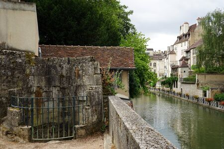 apartment tower old town: Canal in Old town Dole, France