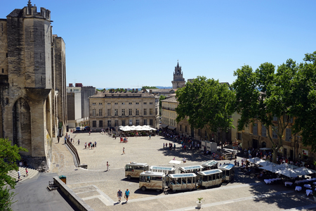 pope: AVIGNON, FRANCE - CIRCA JULY 2015 Tourist train on the Main square and pope palace