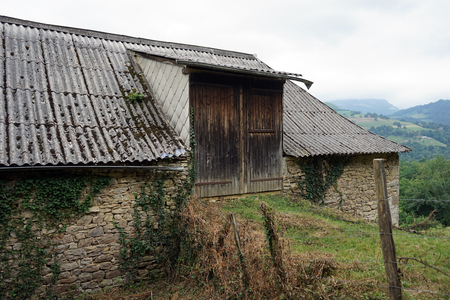 non urban: Stone farrm house with wooden door in Pyrenee, France
