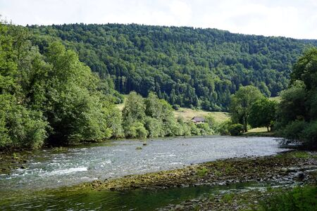 River Doubs and forest in Switzerland Stock Photo