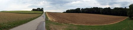 non urban: Panorama of road and farm fields in Switzerland