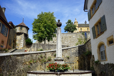 obelisk: NEUCHATEL, SWITZERLAND - CIRCA JULY 2015 Fountain with obelisk on the street