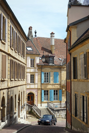corner clock: NEUCHATEL, SWITZERLAND - CIRCA JULY 2015 Car on the narrow street