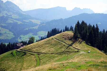 non urban: Road on the slope of hill near mountain in Switzerland Stock Photo