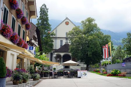 klaus: SACHSELN, SWITZERLAND - CIRCA AUGUST 2015 Cafe and Saint Bruder Klaus church on the main street