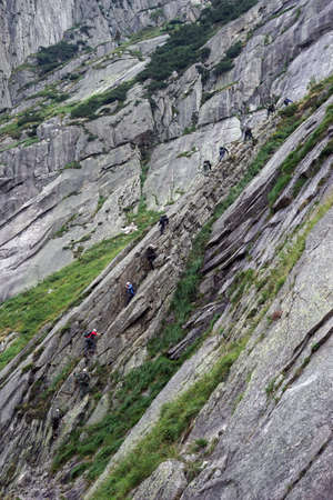 clambering: Group of climbers on the rock near Andermatt in Switzerland