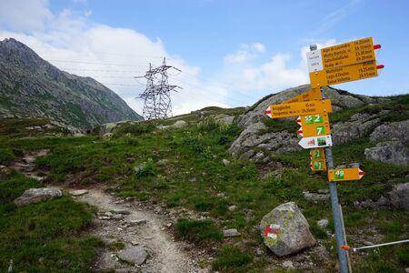 isolator high voltage: GOTTHARD PASS, SWITZERLAND - CIRCA AUGUST 2015 Signs on the footpath Editorial