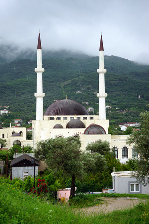 minarets: Mosque with two minarets in Old Bar in Montenegro