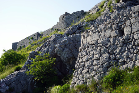 architecture alphabet: wall of Saint Andrey fortress on the mount near Kotor bay Stock Photo