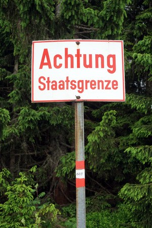 Attention sign on the border between Slovenia and Austria Stock Photo