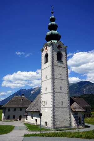corner clock: Bell tower with clock in small village in Austria