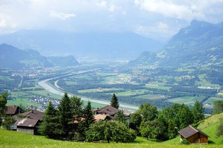 rein: View of Rein valley and farm houses in Lichtenstein Stock Photo