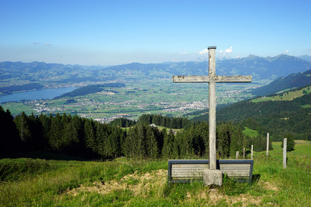Wooden cross on the hill and lake Zurich in Switzerland