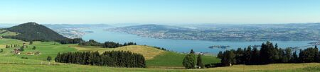 Panorama of green pasture and lake Zurich