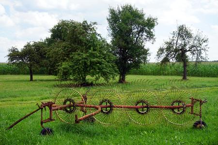 harrow: Harrow on the green field and trees