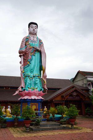 QUY NHON, VIETNAM - 21 JANUARY 2017 Standing Buddha in Chua Minh Tinh pagoda