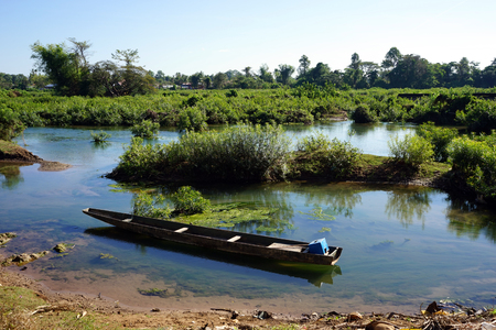 Old boat and Mekong river near Don Det island, Laos Stock Photo