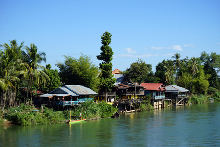 Houses on the Don Det island in Siphandon, Laos Stock Photo