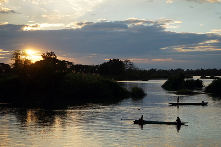 Boat on the Mekong river and sunset Stock Photo