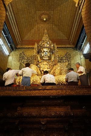 MANDALAY, MYANMAR - CIRCA APRIL 2017 People near Mahamuni Buddha in Maha Myat Muni Pagoda
