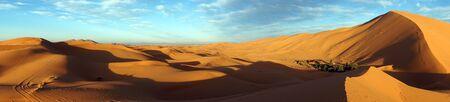 Shadows and sand dunes in Sahara desert near Merzuga village in Morocco