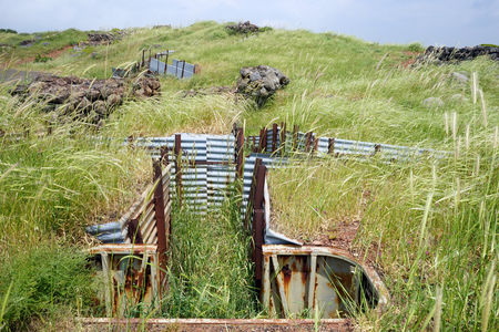 Old trench and green grass in Golan Heights in Israel Stock Photo