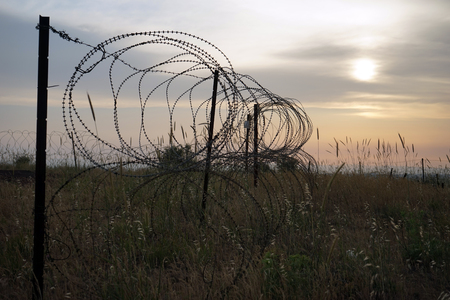 Barber fence and sunset in Golan Heights in Israel