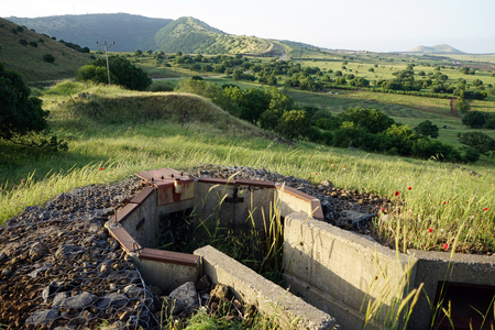 Old ditch near the hill in Golan Heights in Israel Foto de archivo