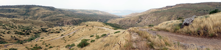 Dirt road on the slope and panorama of Galilee, Israel Stock Photo