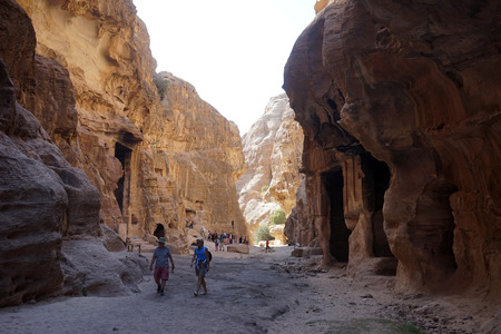 PETRA, JORDAN - CIRCA NOVEMBER 2018Tourists and rock temples in Small Petra