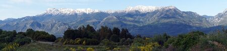 Panorama of snow mountain and road near Sparta in Greece