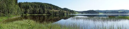 Panorama of lake and forest in Norway Archivio Fotografico - 129467674