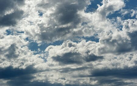 silver clouds on blue sky