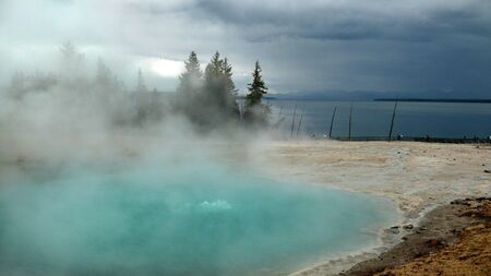 Geyser besides lake hot and cold