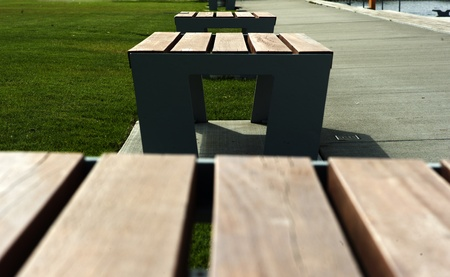 Simple benches in public park in spring.