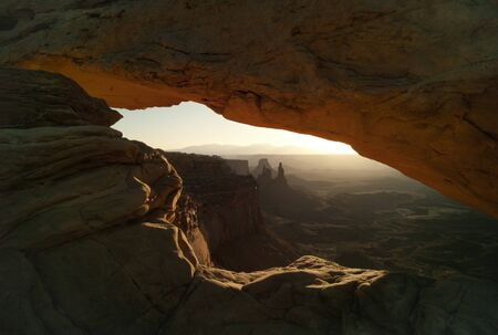 Mesa Arch in Canyonlands National Park early morning at sunrise. Stock Photo