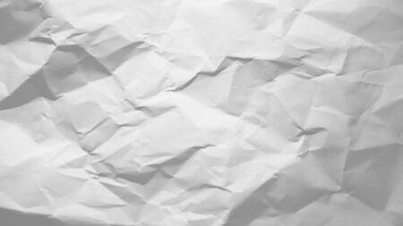 Crinkled sheet of white paper.
