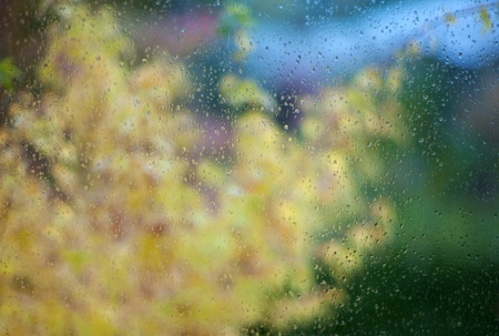 Water drops on window glass surface with scenic background Stock Photo