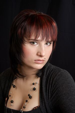 Portrait of the young woman on a black background photo