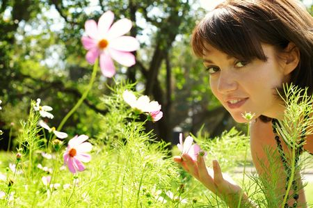 The young beautiful woman in the meadow of chamomiles photo