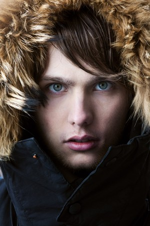 fur hood: Portrait of young attractive man with a serious look Stock Photo
