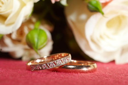 Wedding rings on red cloth photo