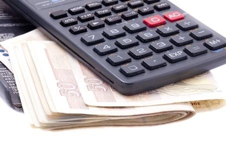 Calculator with money Stock Photo