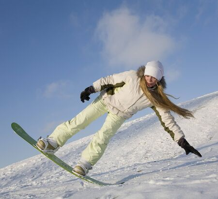 agility people: young woman on snowboard doing tricks Stock Photo