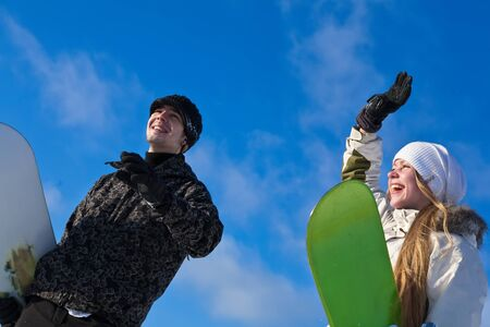 young smiling couple with snowboards at winter day Stock fotó