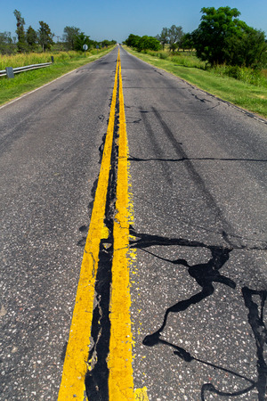Asphalt Road texture and Road yellow color marking to separated driving lanes