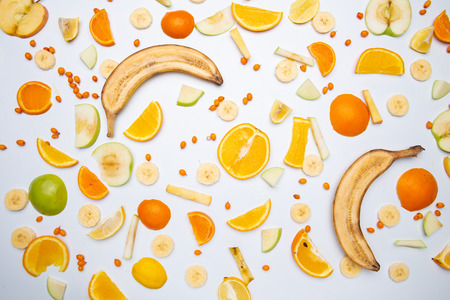 Variety of fresh fruits for making juice or smoothie over white background, top view, horizontal composition. Healthy eating, vitamin, detox, diet food, clean eating concept Stock Photo
