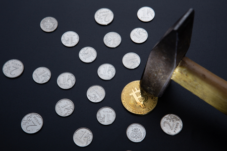 hit golden bitcoin coin with hammer and beams made of silver coins going from center on black background. mining concept, farming.