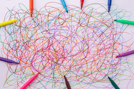 different colors felt tip pens and scribble on white paper, abstract, creative concept, children drawing Stock Photo